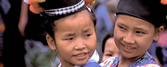 Two girls from the Hmong group embrace