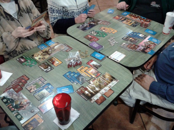 A six-player game of 7 Wonders with the Cities expansion included. Players have their Wonder in front of them, with the cards played around it representing their cities as they develop.
