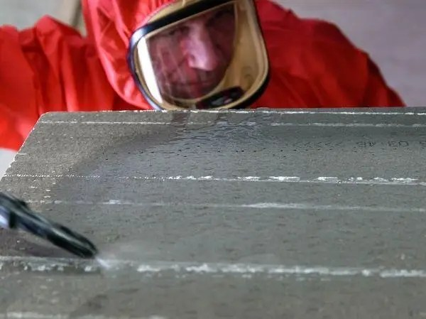 Asbestos removal training - operative in red suit
