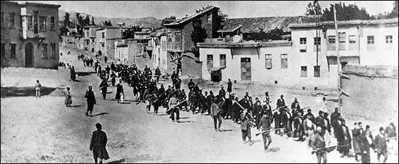 Armenians being marched out of Harput.  Red Cross/Burning Tigris