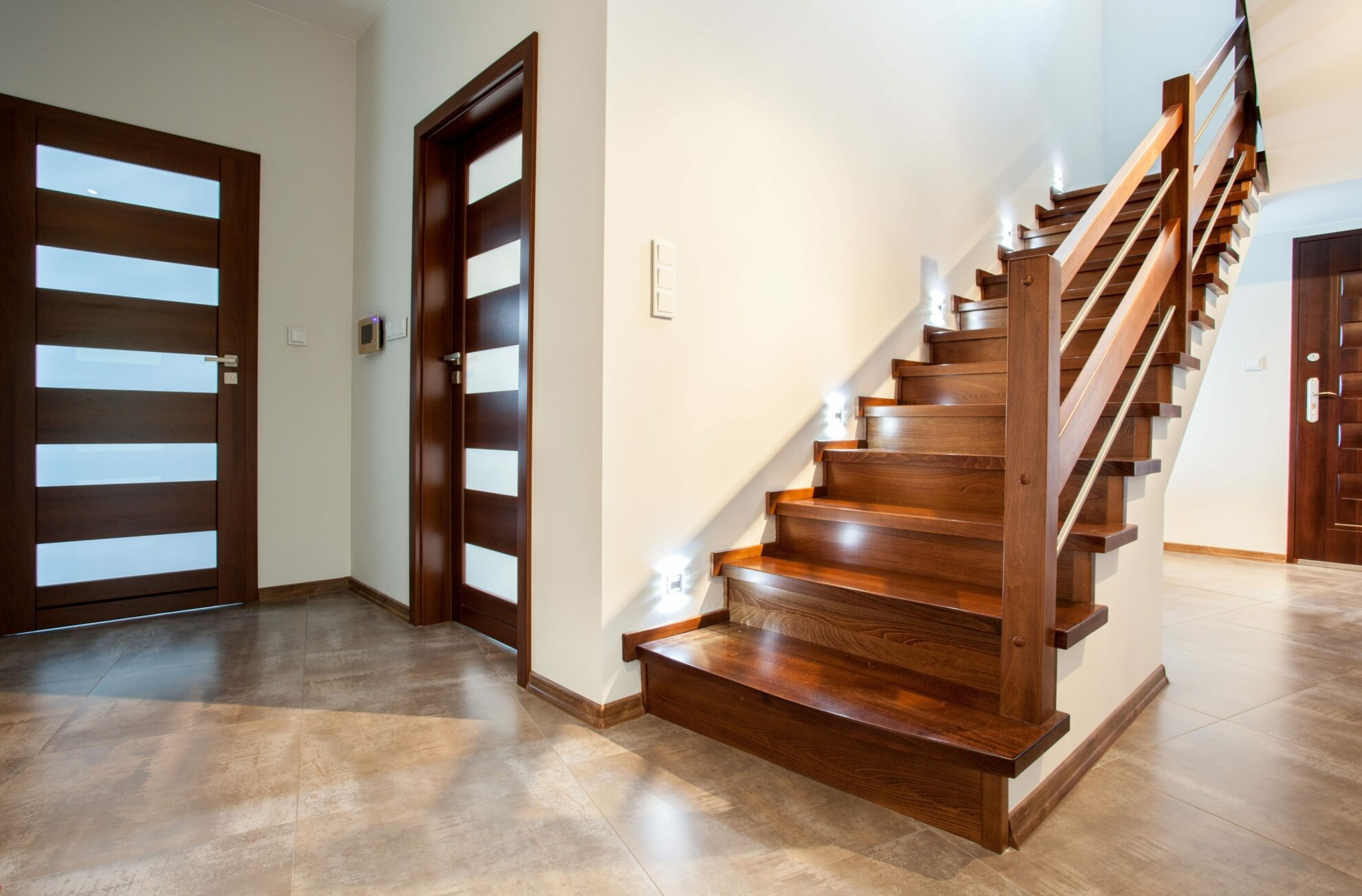How Much Does Refinishing Hardwood Stairs Cost   Staircase Refinishing Near Me   Basement   Restaining   Brown Stained   White Riser   Grey Flooring