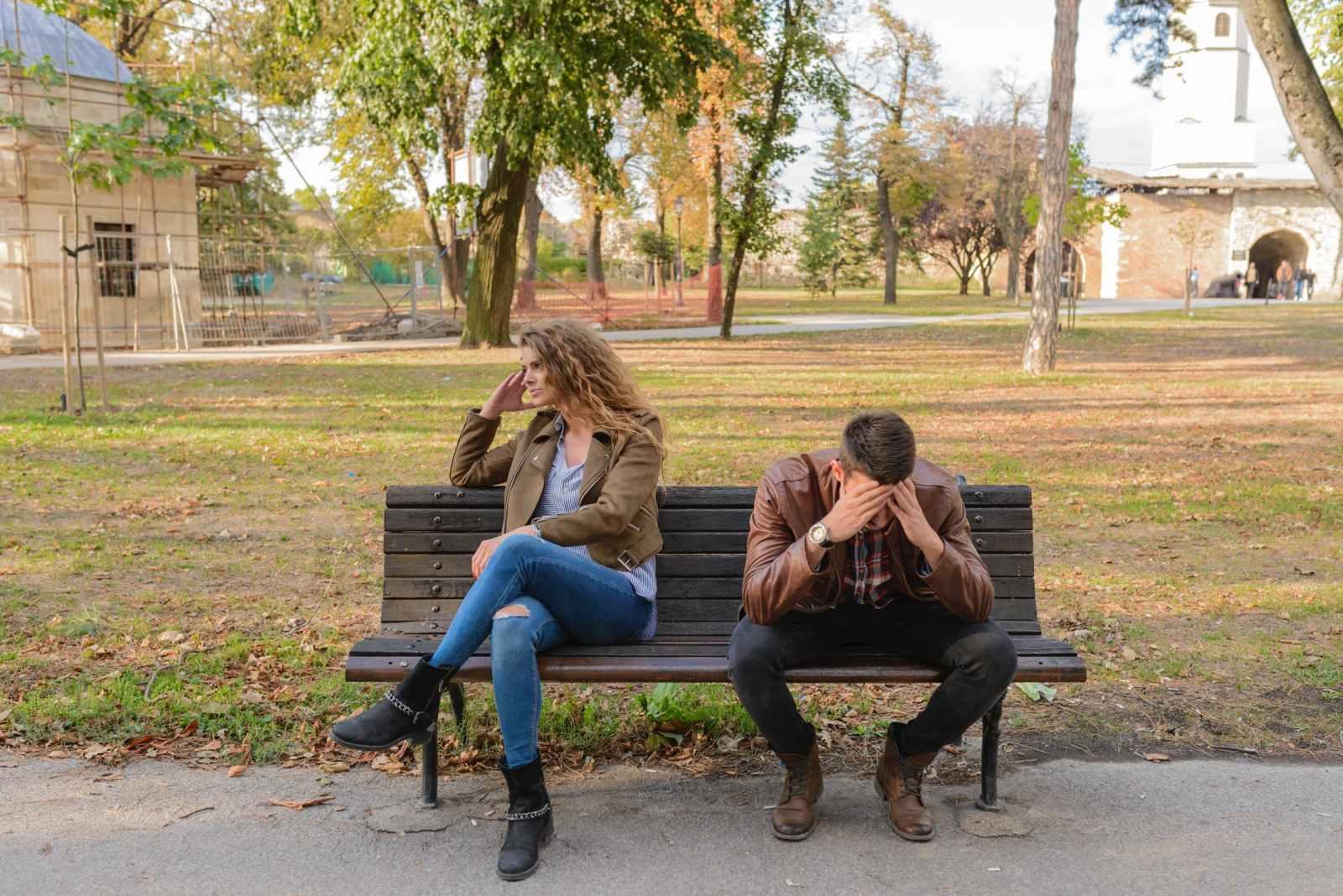 Unhappy couple on bench