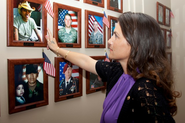 Gold Star mother Jennifer Owens views a photo of her daughter Spc. Ember Marie Alt at the Survivor Outreach Services Remembrance Hall in Fort Hood, Texas. Owens credits Survivor Outreach Services staff members for helping her cope with her loss of her daughter. U.S. Army photo