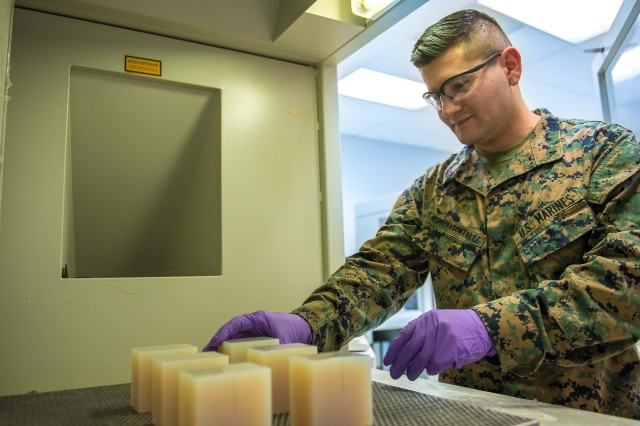 Marine Corps Lance Cpl. Juan Herreragonzalez works with 3-D printed molds at an Army research facility at Aberdeen Proving Ground, Maryland, Jan. 12, 2017.