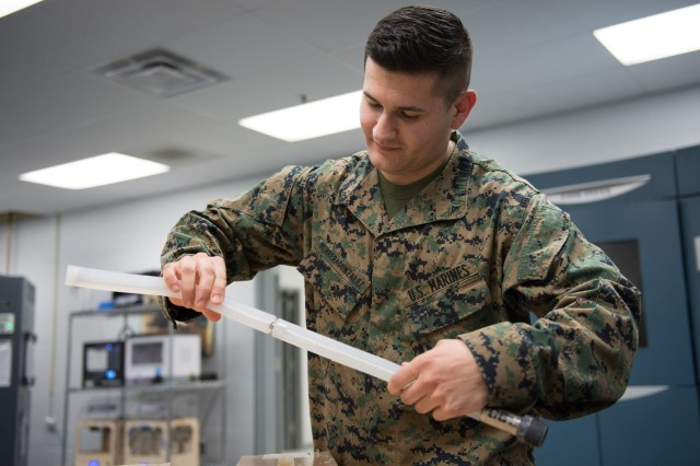 Hydraulic mechanics need to bend tubes to fit them into aircraft they maintain. Marine Corps Lance Cpl. Juan Herreragonzalez (pictured) and Cpl. Habtamu Sharew submitted an idea to the 2016 Marine Corps Logistics Challenge to streamline maintenance procedures.