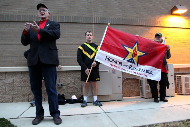"""Mark Stets speaks to a formation of 8th Military Information Support Battalion, 4th Military Information Support Group, Paratroopers and leaders following a battalion four-mile run on Feb. 3, 2017, honoring his son, Staff Sgt. Mark Stets, Jr., who was killed in action Feb. 3, 2010. Unit leaders and Stets' parents took time before and after the run to speak of their memories of the fallen Soldier. The formation ran with Stets' """"Honor and Remember"""" flag in front of the battalion colors."""