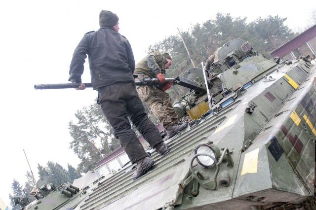 Ukrainian army soldiers reattach the 30 mm barrel of their BMP-2 armored vehicle before they move onto a gunnery range at the International Peacekeeping and Security Center, near Yavoriv, Ukraine, on Feb. 17.