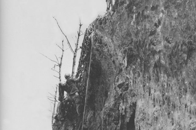 Doss (seen here at the top of Hacksaw Ridge) dragged severely injured men to the edge of the cliff and lowered them down to other medics below.