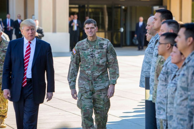 President Donald J. Trump and Army Gen. Joseph L. Votel, commander of U.S. Central Command, spend a few minutes with troops on their way to a news briefing at MacDill Air Force Base, Fla., Feb. 6, 2017. President Trump visited Centcom headquarters to discuss issues relevant to the command's area of responsibility.