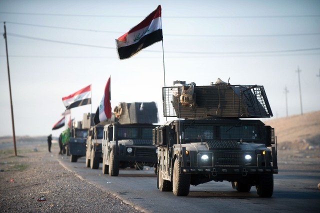 An Iraqi counterterrorism service convoy moves from Baghdad toward Mosul, Iraq, as part of the effort to liberate Mosul from the Islamic State of Iraq and Syria, Feb. 23, 2017.