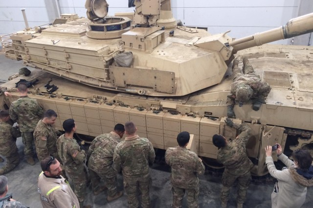 Tank and maintenance crews with 1st Battalion, 66th Armor Regiment, 3rd Armored Brigade Combat Team, 4th Infantry Division, install M1A2SepV2 Abrams reactive armor tiles (ARAT) at the 7th Army Training Command's Grafenwoehr Training Area, Germany, Feb. 28, 2017. The installation of the ARAT will enhance the tank's defensive capabilities, providing a greater deterrent against aggression as the 3rd ABCT maintains a persistent presence in central and eastern Europe as the rotational ABCT for Atlantic Resolve.
