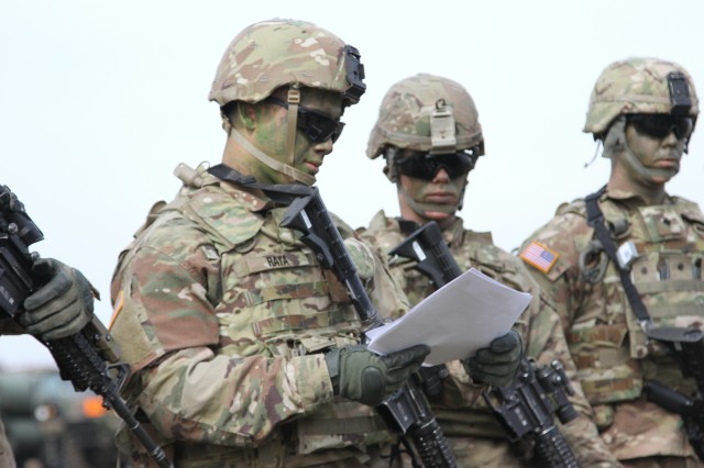 U.S. Army Pvt. Daniel Raya, a member of Bravo Company, 1st Battalion, 8th Infantry Regiment, 3rd Armored Brigade Combat Team, 4th Infantry Division, from Fort Carson, Colorado, takes a look at training documents as he's being briefed on proper aircraft entry and exit at Mihail Kogalniceanu Air Base, Romania on March 3, 2017. The training is a part of Operation Atlantic Resolve, a mission to strengthen European and US relations as well as to deter aggression across Europe. (US Army photo taken by Pvt. Nick Vidro, 7th Mobile Public Affairs Detachment)
