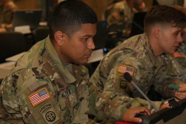 Grafenwoehr, Germany (March 3, 2017) - Spc. Joel Valentingonzalez, an automated tactical data system specialist from the 82nd Airborne Division Artillery in Fort Bragg, NC, reviews fire mission data in the tactical operations center here. Dynamic Front II is an artillery operability exercise taking place at the 7th Army Training Command's Grafenwoehr Training Area, Germany, Feb. 26 to March 10. (US Army photo by Staff Sgt. Kathleen V. Polanco)