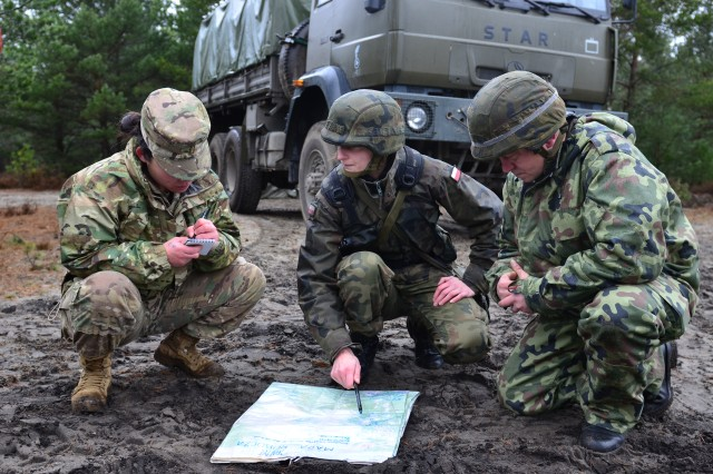 U.S. and Polish soldiers discuss possible locations of a simulated Chemical, Biological, Radiological and Nuclear attack as part of a bi-lateral training exercise at Swietoszow Training Area in Swietoszow, Poland Mar. 7, 2017. Operation Atlantic Resolve, a U.S. led effort in Eastern Europe that demonstrates U.S. commitment to NATO and dedication to enduring peace and stability in the region. (U.S. Army photo by Sgt. Justin Geiger)