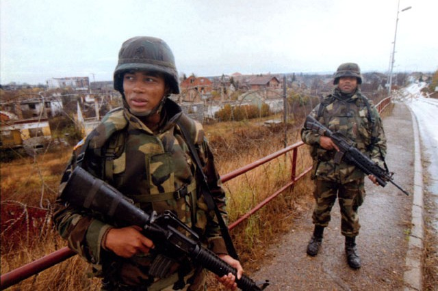 File photo of U.S. Army Soldiers patrolling in the Balkans.