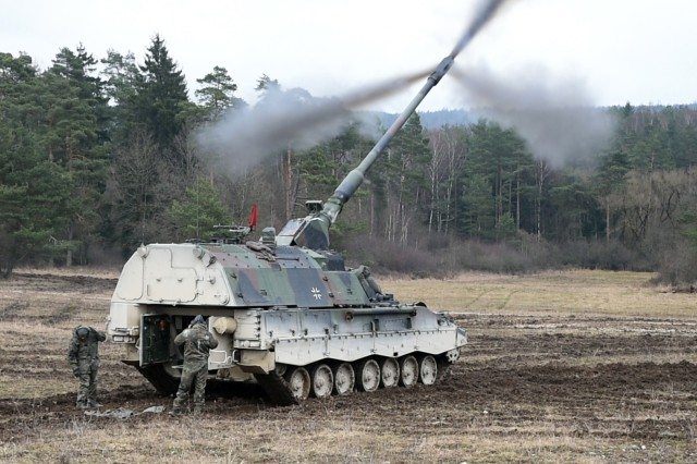 Germany's 131st Artillery Battalion fires a 155mm Panzerhaubitze 2000 during an artillery operability exercise, Dynamic Front II, taking place at the 7th Army Training Command in Grafenwoehr, Germany.