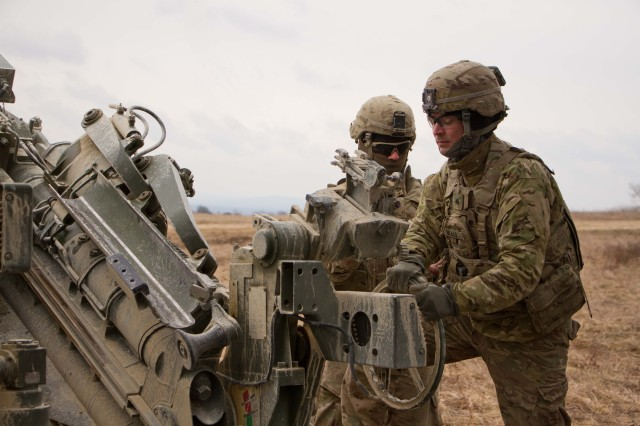 Sgt. David Beale (front), assistant gunner, and Spc. Vincent Ventarola, #1 man , both members of the gun crew for 1st Section, 1st Platoon, Cobra Battery, Field Artillery Squadron, 2d Cavalry Regiment, U.S. Army, conduct a fire mission with their M777A2 Howitzer during a March 8, 2017 in the Grafenwoehr Training Area, Germany. The Squadron participated in Dynamic Front II March 6-9, 2017. The exercise enabled the U.S., Germany and Czech Republic to synchronize their artillery capabilities.