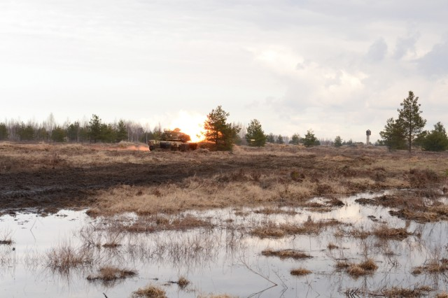 Soldiers from 1st Battalion, 68th Armor Regiment, 3rd Armored Brigade Combat Team, 4th Infantry DIvision, Fort Carson, Colorado, fire at a target on Adazi Military Base, Latvia, March 19. The operation is the first squad-level movement exercise for the unit, who is deployed in eastern Europe for Operation Atlantic Resolve. Operation Atlantic Resolve, a U.S. led effort in eastern Europe, demonstrates U.S. commitment to the collective security of NATO and dedication to enduring peace and stability in the region. (U.S. Army photo by Sgt. Shiloh Capers, 7th Mobile Public Affairs Detachment)
