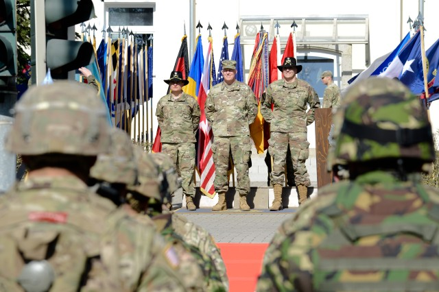 (From Left to Right) U.S. Army Col. Patrick J. Ellis, Commander of the 2nd Cavalry Regiment (2CR), U.S. Army Maj. Gen. Timothy McGuire, U.S. Army Europe's Deputy Commanding General and U.S. Army Lt. Col. Steven Gventer, Commander of the 2nd Squadron, 2CR, stand before Soldiers, with Battle Group Poland, at the Battle Group Poland Departure Ceremony, March 25, 2017, at the 2nd Cavalry Regiment Headquarters, in Vilseck, Germany. Battle Group Poland is comprised of U.S. Soldiers, assigned to the 2nd Cavalry Regiment, and soldiers, from the United Kingdom and Romania. Battle Group Poland will convoy from Vilseck, through Germany, Czech Republic and Poland to reach their destination in Orzysz, Poland, where they will remain for six months as a deterrence force, as part of Enhanced Forward Presence. (U.S. Army photo by Spc. Emily Houdershieldt)