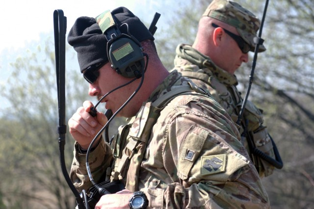 Operations officer, Maj. Luke Kimbrel (front) and Lt. Col. Colby Wyatt (back), commander of 1st Battalion, 179th Infantry Regiment, 45th Infantry Brigade Combat Team, communicate with company commanders observing the combined-arms battalion live-fire exercise held at the Yavoriv Combat Training Center located on the International Peacekeeping and Security Center near Yavoriv, Ukraine on March 29, 2017. The Oklahoma Army National Guardsmen are deployed in support of Joint Multinational Training Group-Ukraine, a mission geared towards training and professionalizing the Ukrainian army and developing Ukrainian combat training center staff.