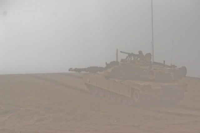 """U.S. Soldiers from Company B, 1st Battalion, 68th Armored Regiment, 3rd Armored Brigade Combat Team, 4th Infantry Division, out of Fort Carson, Colo., hold their position in an M1A1 Abrams as a part of a combined exercise """"Savage Wolf"""" with their Lithuanian counterparts as part of Operation Atlantic Resolve, April 4. The U.S. and Lithuanian Soldiers are split into two integrated teams and are given either an offensive role in taking an 'airfield' or defensive role to keep their position on the 'airfield'. The U.S. and our Allies and partners are making strides toward interoperability by continuously training together and implementing innovative solutions to common problems. Operation Atlantic Resolve is a U.S. led effort in Eastern Europe that demonstrates U.S. commitment to the collective security of NATO and dedication to enduring peace and stability in the region. (U.S. Army photo by Staff Sgt. Charlene Moler)"""