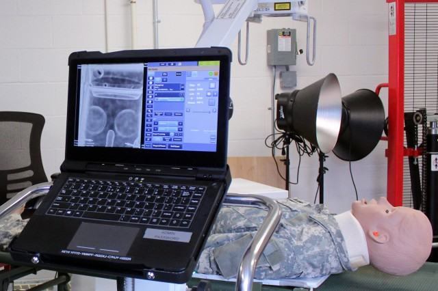 The U.S. Army Medical Materiel Agency will field a new Portable Digital Radiography System (PDRS) that will replace two aging devices, including an X-ray generator and an accompanying computerized reader system. The PDRS combines these capabilities into a single lightweight X-ray unit intended for use by deployed medical, Special Operations and Mortuary Affair Army units. Photo by Ellen Crown, US Army Medical Materiel Agency.