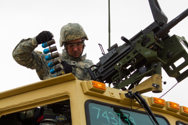 US Army Reserve Spc. Adam Paquet, a petroleum and supply specialist with the 277th Quartermaster Company, 377th Theater Sustainment Command, lifts rounds for a MK19 grenade launcher in preparation for qualification as part Operation Cold Steel at Fort McCoy, Wis., April 2, 2017.