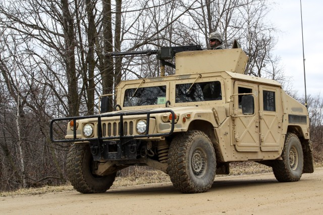 Army Reserve Soldiers from the 430th Quartermaster Company, based out of Fort Buchanan, Puerto Rico, return from a firing exercise as part of Operation Cold Steel at Fort McCoy, Wis., on March 31, 2017.