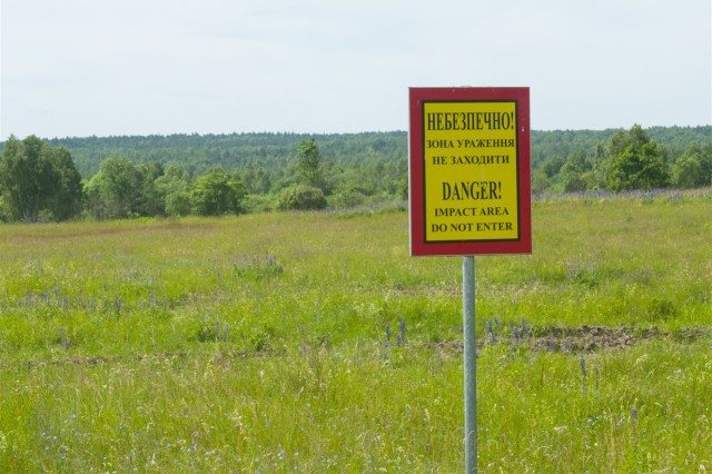 A warning sign marks an impact area at the Yavoriv Combat Training Center on the International Peacekeeping and Security Center near Yavoriv, Ukraine. Range improvement operations are currently in progress to clear several areas on the IPSC of unexploded ordinance. Four civilian demining teams, contracted by the U.S. Army through the Joint Multinational Training Group-Ukraine, are working toward the goal of clearing 1,800 hectares of UXO by 2018.