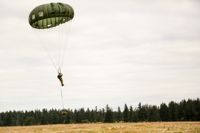 A Soldier with 1st Special Forces Group (Airborne) conducts airborne operations at Merrill Drop Zone, Joint Base Lewis-McChord, Wash. on June 27.
