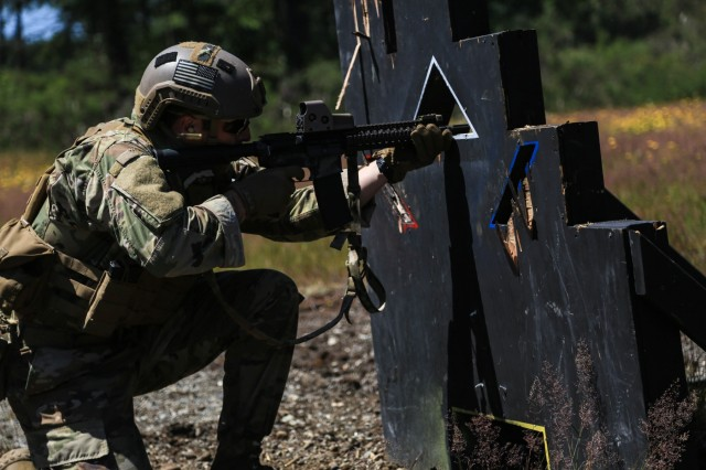 """A Soldier from 3rd Battalion, 1st Special Forces Group (Airborne), participates in a stress shoot during """"Dragon Week"""" at Range 103, Joint Base Lewis McChord, Wash., June 29. Dragon Week consisted of airborne operations, maritime operations, patrol lanes, a stress shoot, and medical evaluations to test readiness at the battalion level."""