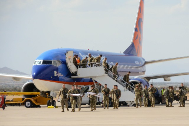 """Soldiers with 2nd Brigade Combat Team, 101st Airborne Division from Fort Campbell, Kentucky, disembark the plane during their arrival for the Network Integration Exercise 17.2, here, July 5. The """"Strike"""" Brigade with 101st ABN DIV is the first rotational brigade to conduct NIE here."""
