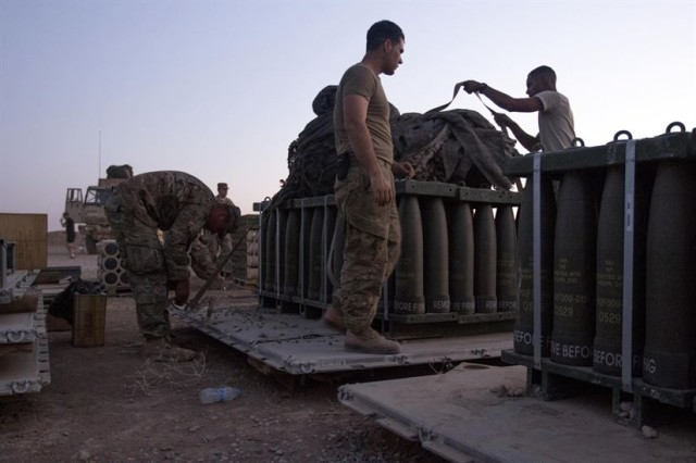 Paratroopers, with Charlie Battery, 2nd Battalion, 319th Airborne Field Artillery Regiment, 82nd Airborne Division, work late into the evening preparing munitions for movement at Forward Operating Base Shalalot, Iraq, July 6, 2017. The fuel, ammunition and life support essentials needed to sustain the fight against ISIS in the U.S. Army Central Command area of operations are provided by U.S. Army Reserve Soldiers from the 316th Sustainment Command (Expeditionary), acting as the 1st Sustainment Command (Theater) Operational Command Post, in Camp Arifjan, Kuwait. The 1st TSC has provided approximately 22 million rounds of ammunition, nearly 3 million gallons of fuel, over 1,000 vehicles, nearly 400 million gallons of water and more than 13,000 weapons.