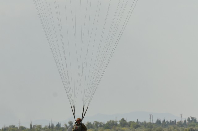 VAZIANI TRAINING AREA, Georgia - A British Soldier of the 2nd Battalion, Parachute Regiment (2nd PARA), 16th Air Assault Brigade, Essex, England, lands on the drop zone at Vaziani Training Area, Georgia, Aug. 7, 2017. The 2nd PARA is currently in the Republic of Georgia to participate in Exercise Noble Partner. Noble Partner is a multinational, U.S. Army Europe-led exercise conducting home station training for the Georgian light infantry company designated for the NATO Response Force. (U.S. Army photo by Sgt. Shiloh Capers)