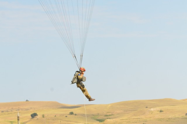 VAZIANI TRAINING AREA, Georgia - A British Soldier Pvt. Josh Street, 2nd Battalion, Parachute Regiment (2nd PARA), 16th Air Assault Brigade, Essex, England, prepares to land, at the drop zone on Vaziani Training Area, Georgia, Aug. 7, 2017. The red tape signifies first-time jumpers. The 2nd PARA is currently in the Republic of Georgia to participate in Exercise Noble Partner. Noble Partner is a multinational, U.S. Army Europe-led exercise conducting home station training for the Georgian light infantry company designated for the NATO Response Force. (U.S. Army photo by Sgt. Shiloh Capers)