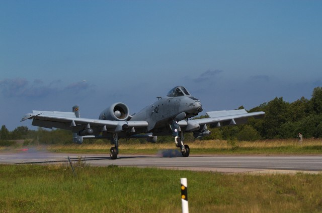 "A US Army A-10 Thunderbolt II ""Warthog"" belonging to the 175th Wing, Maryland Air National Guard, lands on a stretch of highway during an exercise near Jagala, Estonia on August 10, 2017. The exercise was a chance for the public to see NATO forces working together as a part of Operation Atlantic Resolve, which is a NATO mission involving the US and Europe in a combined effort to strengthen bonds of friendship and to promote peace. (Photo taken by Pfc. Nicholas Vidro, 7th Mobile Public Affairs Detachment.)"