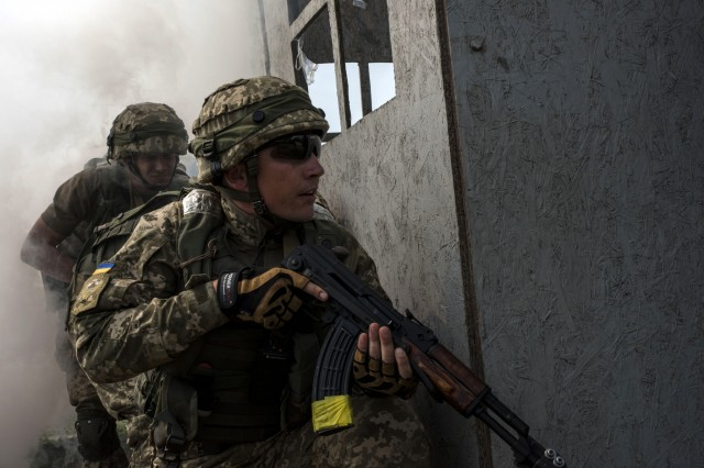 Ukrainian soldiers prepare to search a building for a high value target during security operations training at Exercise Rapid Trident 16, July 1, 2016. (U.S. Army photo by Sgt. 1st Class Whitney Hughes/Released)