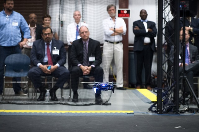 Army Research Laboratory officials and visiting research partners observe micro-robotics demonstrations at Aberdeen Proving Ground, Maryland.