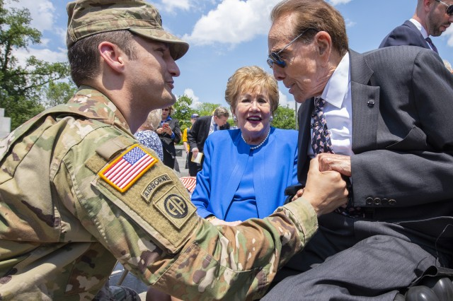 Former Sen. Bob Dole shakes hands with Lt. Col. Michael Lind with the Army's G-1 office during Dole's honorary promotion ceremony at the World War II Memorial in Washington, D.C., May 16, 2019. Dole, who was medically discharged as a captain after being severely wounded in WWII, was promoted to colonel.