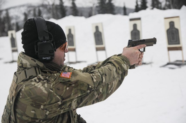 Staff Sgt. Sean E. Davis, a member of 1st Battalion, 297th Infantry Regiment, based in Joint Base Elmendorf-Richardson, Alaska, tests the new SIG Sauer M17 Army service pistol March 1, 2020, in the Yukon Training Area on Eielson Air Force Base as part of exercise Arctic Eagle 2020.