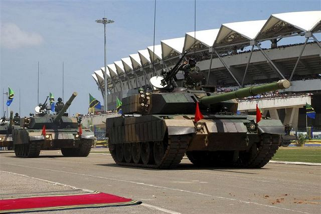 A new chinese upgrade of the Type 59 main battle tank was unveiled during a military parade in Tanzania. Our initial analysis shows that this new Chinese main battle tank upgrade is based on a modified chassis of the old Type 59 with the turret of the new chinese made Type 96G main battle tank.