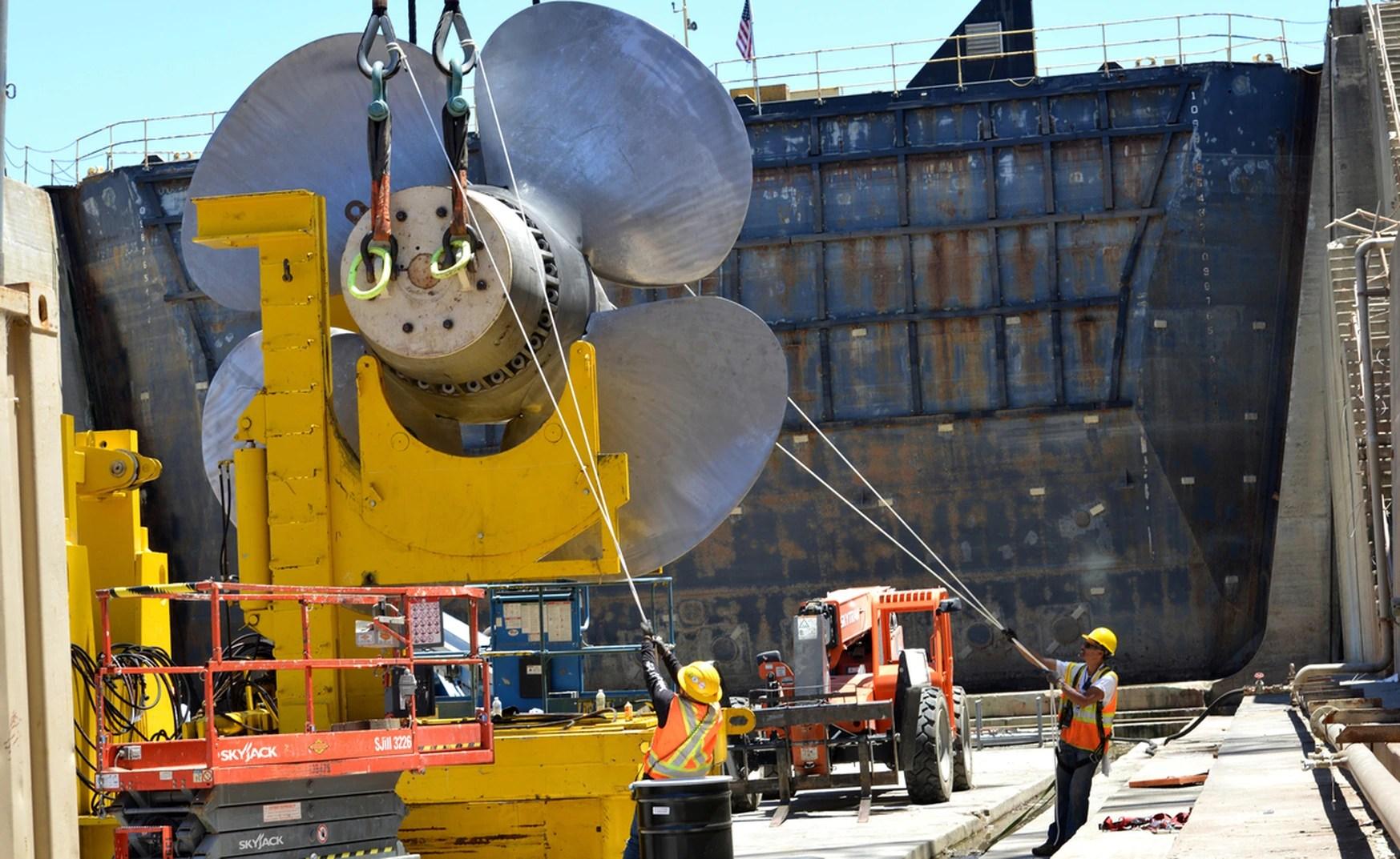 Contractors prepare to replace the 16-foot-diameter propellers on the Coast Guard cutter Polar Star. (Petty Officer 1st Class Matthew S. Masaschi/U.S. Coast Guard)