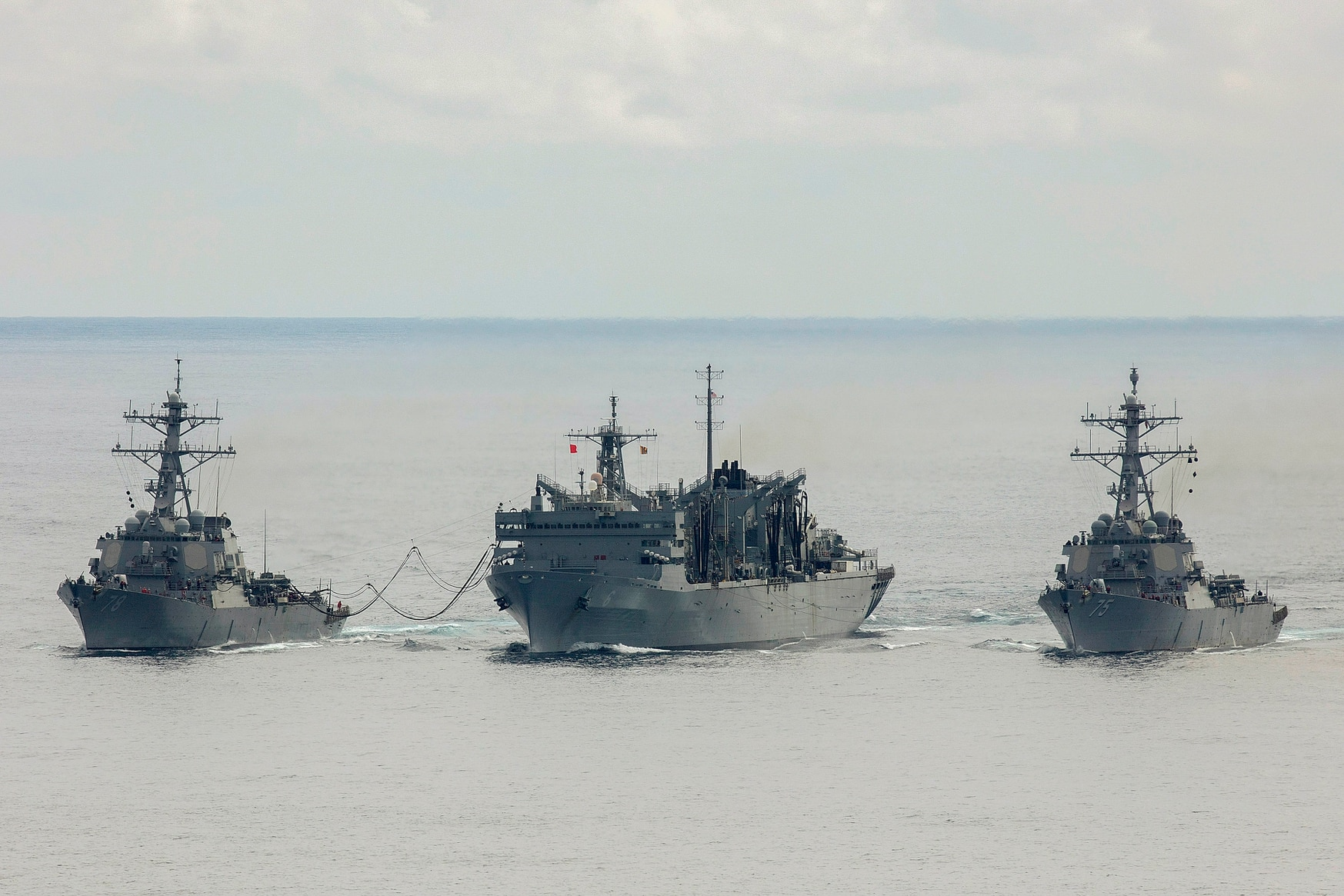 The U.S. Navy destroyers Porter and Donald Cook replenish from the fast combat support ship Supply while operating above the Arctic Circle. (LPhot Dan Rosenbaum/British Royal Navy)