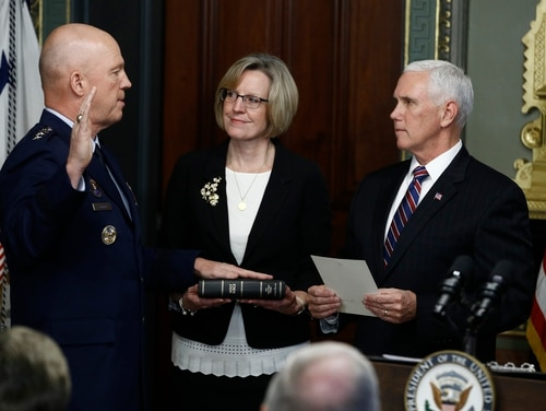 Vice President Mike Pence, right, swears in Air Force Gen. John Raymond, left, as chief of space operations on Jan. 14, 2020. (Steve Helber/AP)