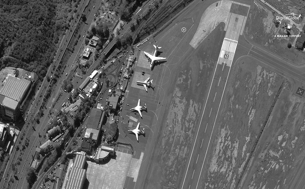In this Dec. 10, 2018, file satellite image provided by DigitalGlobe shows the Simon Bolivar International Airport shortly after four Russian military aircraft arrived in Maiquetia, Venezuela. (DigitalGlobe, a Maxar company via AP, File)
