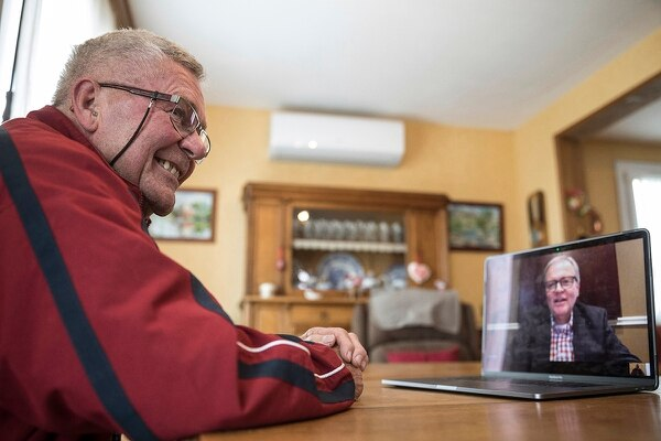 In this photo taken May 8, 2019, Andre Gantois in Ludres, France, talks to his half-brother Allen Henderson, of Greenvile, S.C., during a video-conference. Gantois, the son of an American serviceman who served in France during World War II, recently discovered his half-brother thanks to DNA testing. (Jean-Francois Badias/AP)