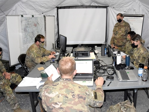 Soldiers with the 2nd Battalion, 4th SFAB, work in their Tactical Operations Center June 3 before deploying to the Joint Readiness Training Center and Fort Polk's training area for Rotation 20-08. (Army)