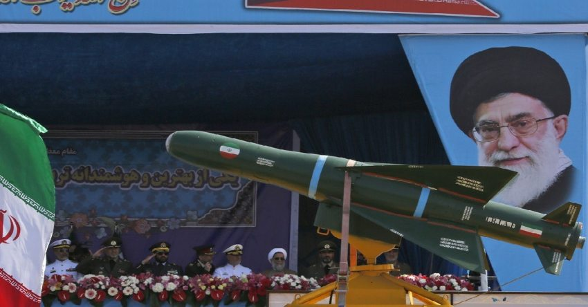 An Iranian military truck carries missiles past a portrait of Iranian Supreme Leader Ayatollah Ali Khamenei during a parade in Tehran on April 18, 2018. (Atta Kenare/AFP via Getty Images)