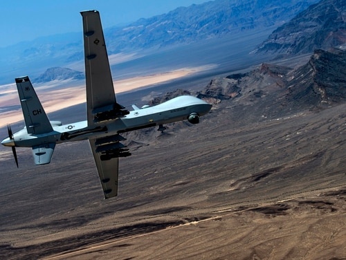 An MQ-9 Reaper remotely piloted aircraft performs aerial maneuvers over Creech Air Force Base, Nevada. (Senior Airman Cory Payne/Air Force)