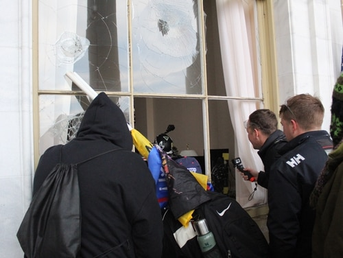 Rioters enter the Capitol building through a smashed window on Jan. 6, 2021. (Kyle Rempfer/Staff)